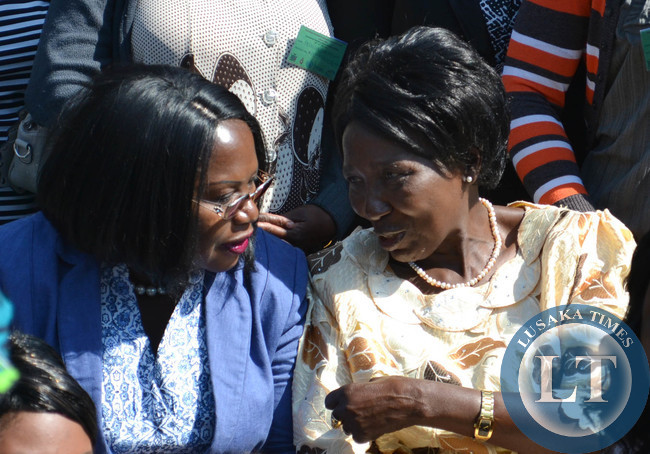 Gender and Child Development Minister Inonge Wina (right) talks to Bank of Zambia Deputy Governor (Administration) Dr Tukiya Kankasa-Mabula at the opening of the national women economic empowerment jubilee expo at Mulungushi International Conference Centre in Lusaka recently