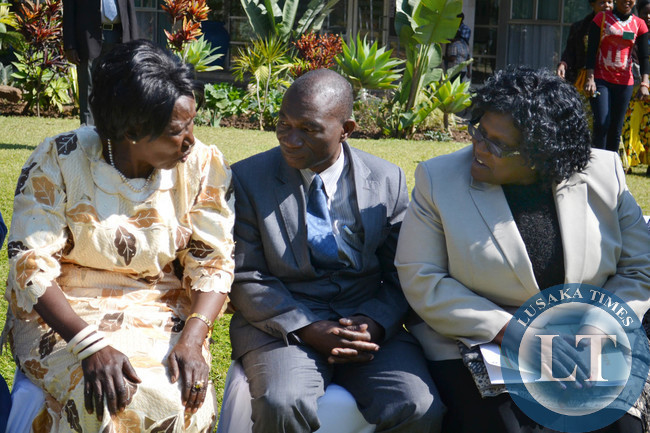 Gender and Child Development Minister Inonge Wina (left) talks to Deputy Minister Obius Chisala (centre) and Permanent Secretary Daisy N'gambi at the opening of the national women economic empowerment jubilee expo at Mulungushi International Conference Centre in Lusaka recently