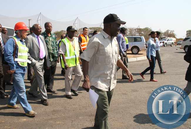 Avic International Deputy Director Liu Xiaodong (left) takes Finance Minister Alexander Chikwanda (second from left), Local Government and Housing Minister Emmanuel Chenda and Road Development Agency Director General Bernard Chiwala on an inspection of one of the roads under construction in Lusaka