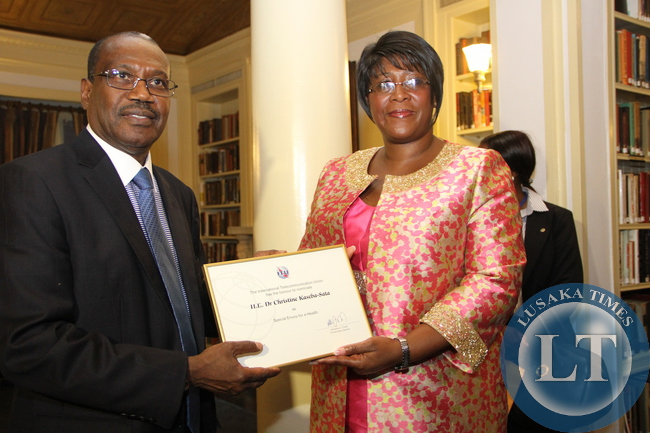 First Lady Dr Christine Kaseba with the International Telecommunication Union Secretary General Dr Hamadoun Toure at Yale Club Library where she was inaugurated as the ITU special Envoy for e-Health. This was on the sidelines of the 69th UN General Assembly in New York on September 21,2014 –Picture by THOMAS NSAMA