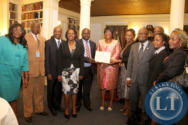 First Lady Dr Christine Kaseba with the International Telecommunication Union Secretary General Dr Hamadoun Toure and some Zambian  at Yale Club Library where she was inaugurated as the ITU special Envoy for e-Health. This was on the sidelines of the 69th UN General Assembly in New York on September 21,2014 –Picture by THOMAS NSAMA
