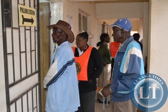 UNIDENTIFIED senior citizens waiting on a queue to exercise their voting rights during  Solwezi Central by-elections