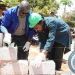 Bank of Zambia Governor Dr. Micheal Ngondwe  and Habitat for Humanity Zambia National director Joseph Munsanji  in laying a blocks during the ground breaking of building a house in kamanga compound