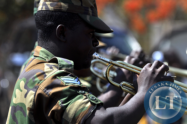 A Zambia Army trumpeter blows his instrument during the independence celebration march past at the freedom statue