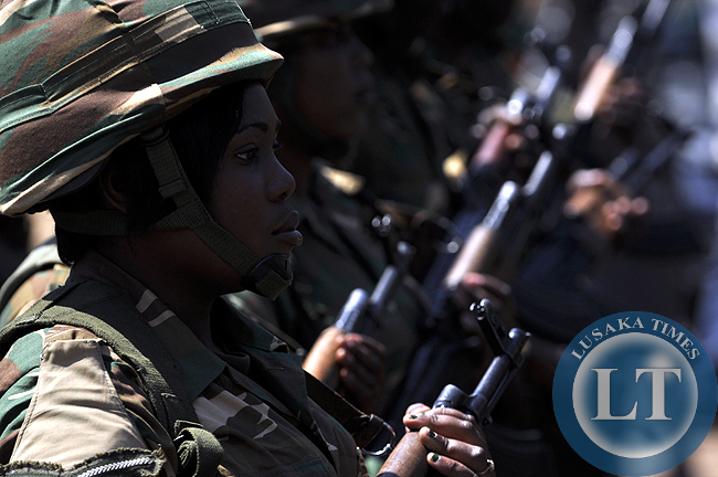 A female Zambia Army soldier captured during the independence day march past at the freedom statue