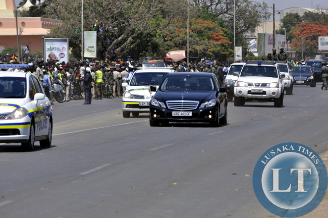 Acting president Edgar Lungu's motorcade drives along Independence avenue after the independence day march past in Lusaka