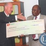 Zambia Minister of Finance Alexander Chikwanda receives a cheque worth of K10 million Eight Hundred Twenty Eight  from Zanaco MD Dick Bruce as a  2013 Divedend Payment to Zambia Government; the ceremony took place at the Ministry  Boardroom in Lusaka.