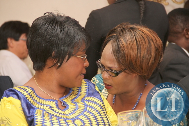 First Lady Dr Christine Sata with chats with Former Zambia's High Commissioner to Kenya Mumbi Phiri during the Golden Jubilee Anniversary of Zambia's Independence and the 50th Anniversary of India -Zambia Diplomatic relations in Lusaka on October 18,2014 -Pictures by THOMAS NSAMA