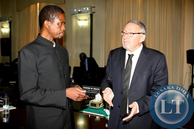 Acting President Guy Scott   listens to Defence and Justice minister Edgar Lungu shortly after Cabinet meeting at State House on October 29,2014 -Picture by THOMAS NSAMA