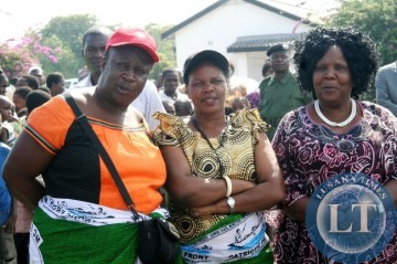 Patriotic Front (PF) Deputy Secretary General Bridget Atanga (c) flanked by Deputy Minister of Tourism Josephine Limata (r) and PF Member of Central Committee Annie kayula (l) waiting for the arrival of PF Secretary General Edgar Lungu at Mongu Airport in Western Province