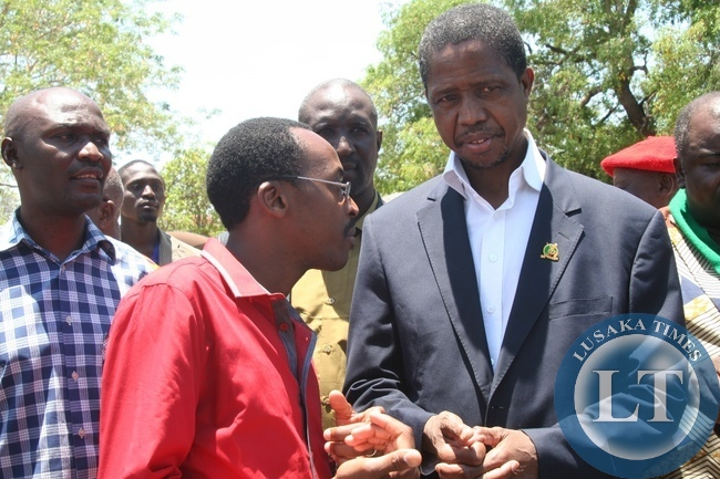 Defense Minister Edgar Lungu (r) who is also PF Secretary General listens to PF Director of Media and Publicity Brian Hapunda (c) after a closed door meeting with the Litunga at the Royal Palace in Limulunga District during the tour of duty of Western Province