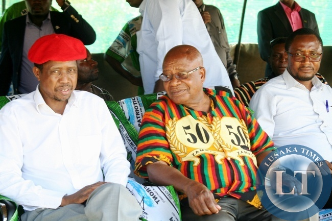 Defense Minister Edgar Lungu (l) who is also PF Secretary General with Southern Province Minister Daniel Munkombwe (c) and Western Province Minister Richwell Siamunene (r) at a PF Rally meeting at Blue Gums in Mongu District of Western Province