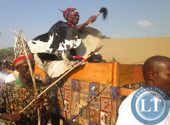 Senior Chief Chipepo Mukuni Ngombe of the Lenje Speaking People is hoisted in his Royal Hammock during the Kulamba Kubwalo Traditional Ceremony in Chibombo last Saturday
