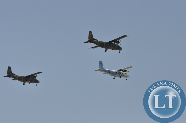 Zambia Air Force Y-12 planes make a fly past at the independence day march past in Lusaka