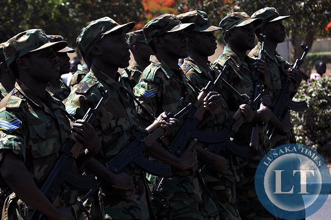 Zambia Ar Force soldiers captured during the independence day march past at the freedom statue in Lusaka