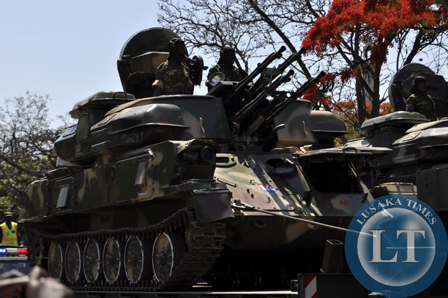 Zambia Army soldiers display their artillery, inlcuding tanks during the independence day march past in Lusaka
