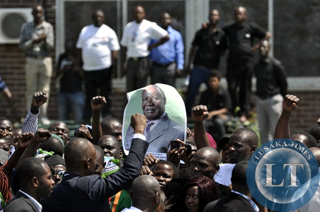 PF supporters chanting slogans for their man, Mulenga Sata before the body of late President Sata arrived