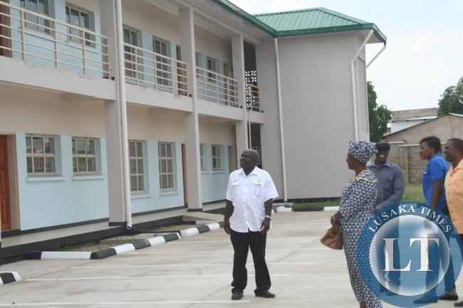 Cabinet Office Permanent Secretary for Special Duties Bert Mushala (l) with Mongu District acting Commissioner Alice Mutemwa (c) inspecting the Lewanika General Hospital Two Story Staff flats which have been completed in Mongu District during the tour in Western Province to compile major developmental projects,