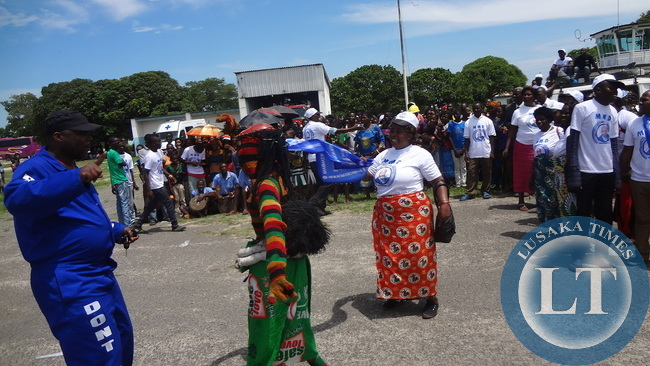 MMD Die Hard National Youth Coordinator Bowman Lusambo engages a traditional dancer in a dance at Mongu airport as they await the arrival of Dr Nevers Mumba