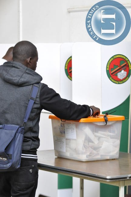 An unidentified voter in the voting booth at City Library Polling centre in Lusaka.