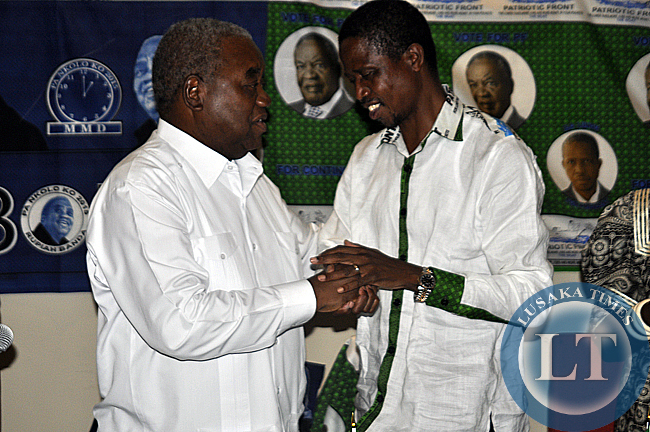 Edgar Lungu and Rupiah Banda clench hands as a sign of unity after the former president announced his support for the PF candidate in the January 20, 2015 elections.