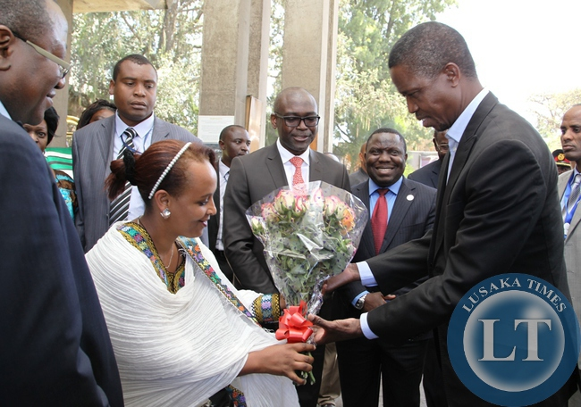 President Edgar Lungu receives a bouquet of flowers from Hilton Guest Relations Manager on arrival at Hilton Hotel in Addis Ababa, Ethiopia.