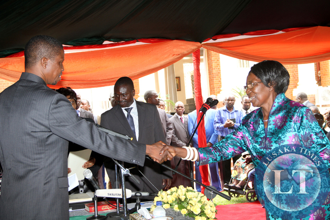 President Edgar Chagwa Lungu congratulates newly apponted  Vice-President Inonge Wina during the Swearing-in-Ceremony at State House on January 26,2015 -Picture by THOMAS NSAMA