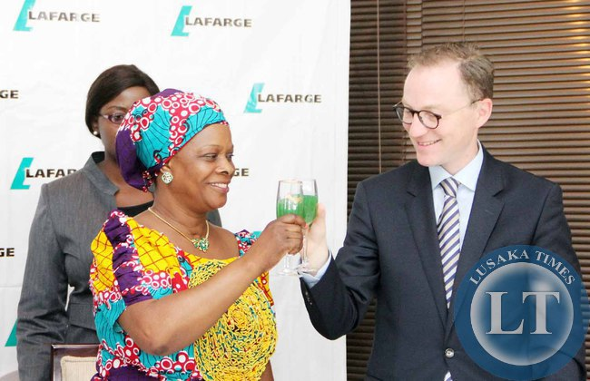 First Lady Esther Lungu toasts with Lafarge  Zambia Chief Executive officer Emmanuel Rigaux (r)   during the Launch of the Lafarge Foundation at Twangale Park in Chilanga, Lusaka on February 19,2015 -Picture by THOMAS NSAMA
