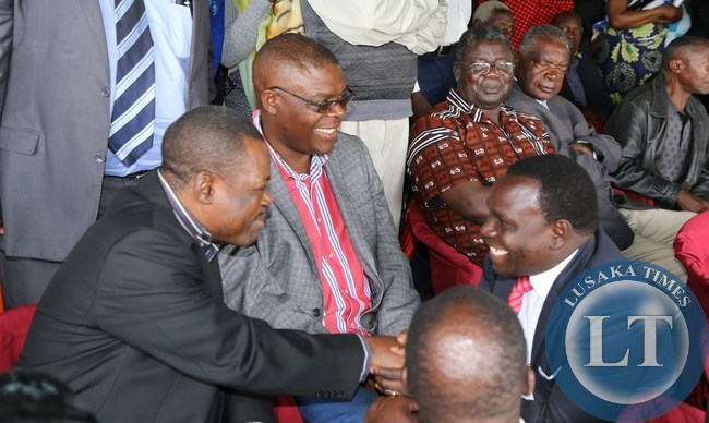 Lusaka Province Deputy Permanent Secretary Bright Nundwe confers with Rainbow Party President Wynter Kabimba during the burial of the late former Chongwe District Commisioner Charles Mwambi at memorial park