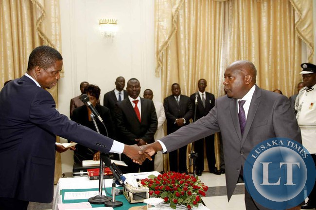 FILE: President Edgar Lungu congratulates Newly appointed Luapula Province Permanent Secretary Boniface Chimbwali   during the Swearing-In-Ceremony State House on February 3,2015 -Picture by THOMAS NSAMA