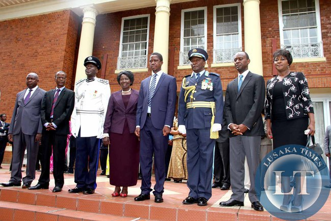 L-R:  Luapula Province permanent Secretary Boniface Chimbwali , Chiefs and Traditional Affairs minister Dr Joseph Katema, Deputy Inspector General of Police Mr Kakoma Kanganja , President Edgar Lungu, Deputy ZAF Commander Maj Gen Muma, State House Deputy minister Mulenga Sata and Commerce minister Margaret Mwanakatwe  during the swearing -in-Ceremony at State House on February  3,2015 -Picture by THOMAS NSAMA