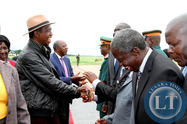 President Edgar Lungu share a light moment with PF  members of the Central Committee  shortly before  he left  for a working holiday in Mfuwe on January 4,2015 -Picture by THOMAS NSAMA