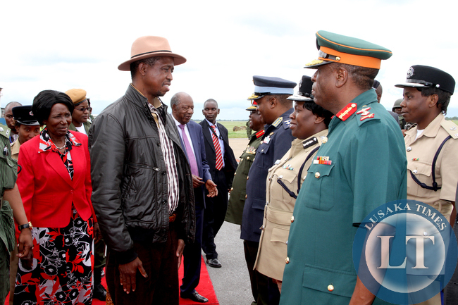 President Edgar Lungu talks to the Inspector General of Police Stella Libongani shortly before  he left  for a working holiday in Mfuwe on January 4,2015 -Picture by THOMAS NSAMA