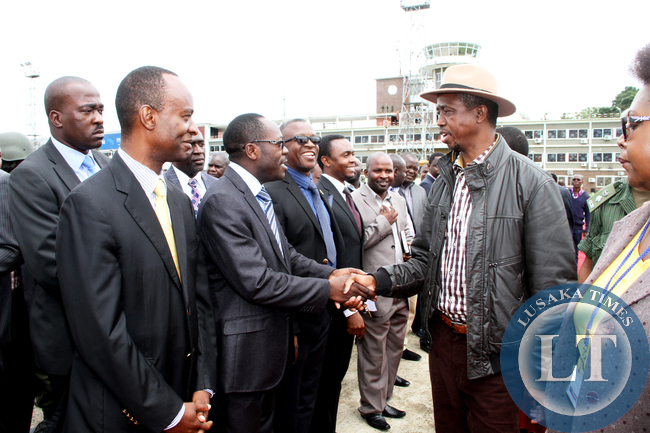 President Edgar Lungu with  his Assistant for Political Affairs  Kaiza Zulu, State House permanent secretary Emmanuel Chilubanama  and State House deputy minister Mulenga Sata  at Kenneth Kaunda International Airpoort shortly before  he left  for a working holiday in Mfuwe on January 4,2015 -Picture by THOMAS NSAMA