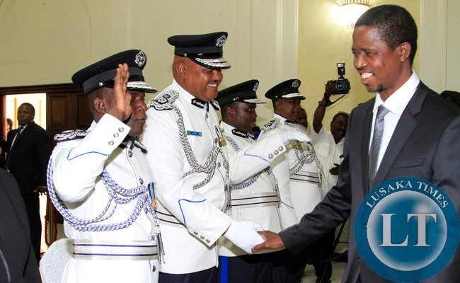 President Edgar Lungu greets the Swearing in Ceremony looking on is Mr Auxensio Daka Comissioner of Police Muchinga Province,and Mr Stanslous Agrippa Mukuka Chewe as Commissioner of Police Northern Province at Statehouse on Thursday 19-02-2015 PICTURE