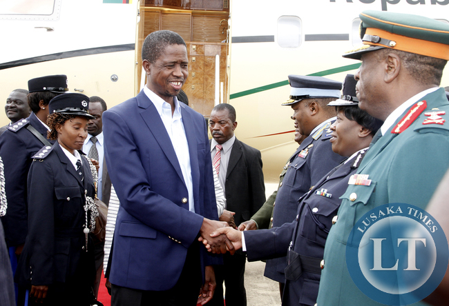 President Edgar Lungu greeting the Inspector General of Police Stella Libongani on arrival at Kenneth Kaunda International Airport from Addis Ababa, Ethiopia where he attended the African Union Summit on February 1,2015 -Picture by THOMAS NSAMA