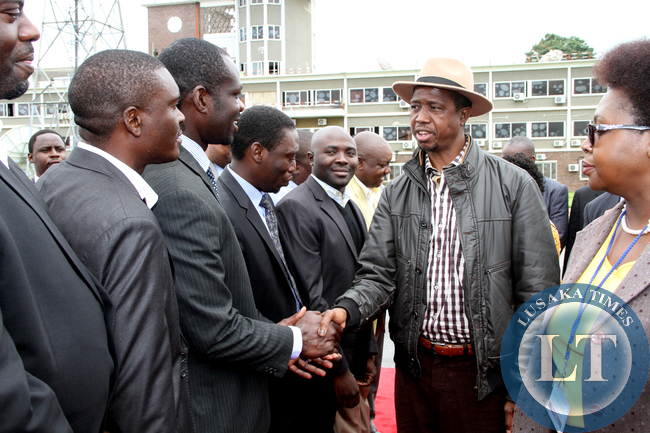 President Edgar Lungu greets PF supporters shortly before  he left  for a working holiday in Mfuwe on January 4,2015 -Picture by THOMAS NSAMA