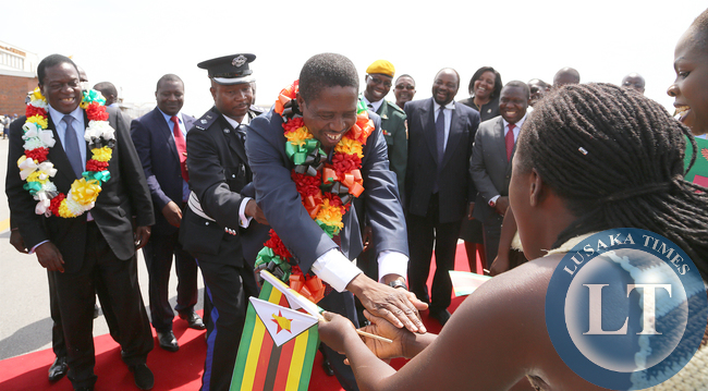 President Edgar Lungu with Zimbabwean vice President Minister Emmerson Mnangagwa at Harare internatioanl airport thanks dancers on arrivial in Zimbabwe. Picture By EDDIE MWANALEZA /STATEHOUSE