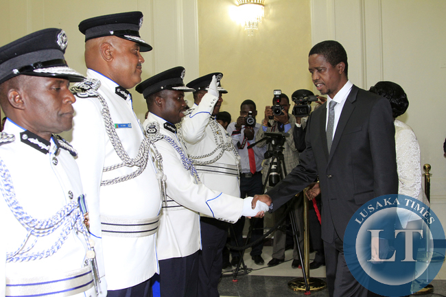 President Edgar Lungu greets Mr Hudson Namachila Comissioner Of Police Eastern Province the Swearing in Ceremony looking on is Mr Auxensio Daka Comissioner of Police Muchinga Province,and Mr Stanslous Agrippa Mukuka Chewe as Commissioner of Police Northe