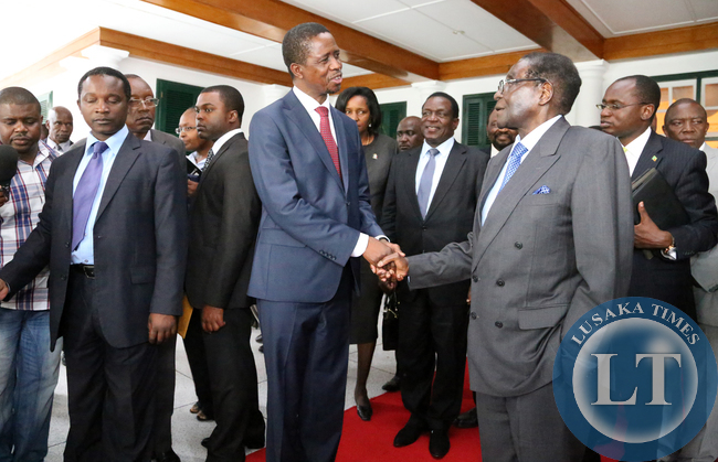 President Edgar Lungu with President Robert Mugabe after 4hours official talks at Harare Statehouse in Zimbabwe on Friday 06-02-2015 PICTURE BY EDDIE MWANALEZA/STATEHOUSE.