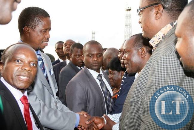 President Edgar Lungu being welcomed by Lusak District Commissioner Captain Mulenga on arrival fro Angola at Kenneth Kaunda International Airport Picture by THOMAS NSAMA