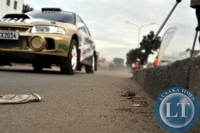A rally car raves off along Freedom Way during the ZMSA national motor rally.