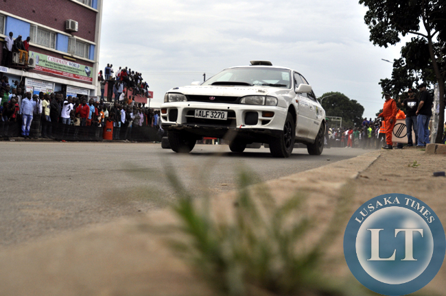 A rally car raves off along Freedom Way during the ZMSA nationa motor rally
