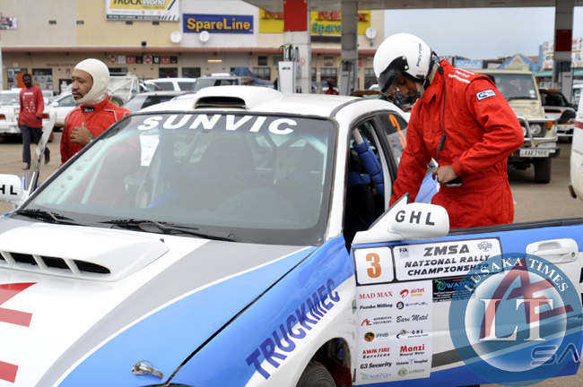 A rally driver about to board his cabin
