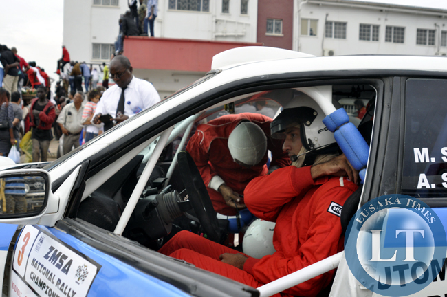A rally driver prepares to rave off on the race track