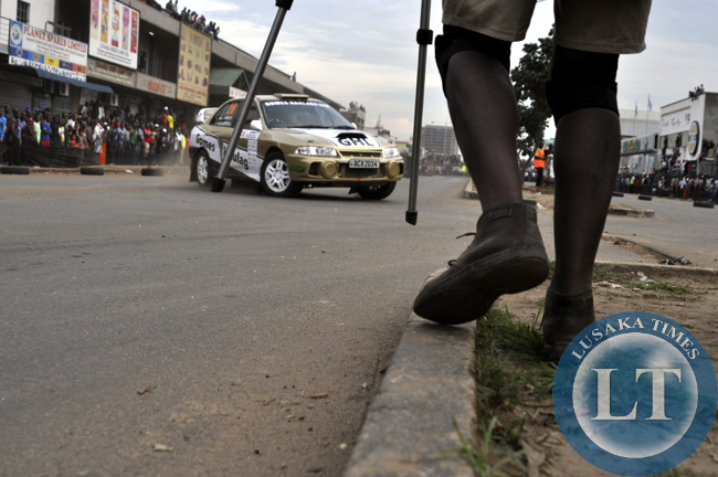 A videographer moves in position to have a vantage point for clear shots during the ZMSA national rally championship