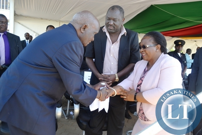 First Republican President Dr Kenneth Kaunda greets Chief justice Irene Mambilima as PF General Secretary Davies Chama looks on at the Freedom statue during the commemoration of the Youth day
