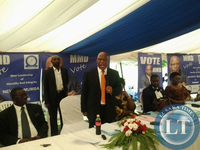 Dr  Nevers Mumba stresses a point at the closing ceremony   of the national policy conference of the MMD