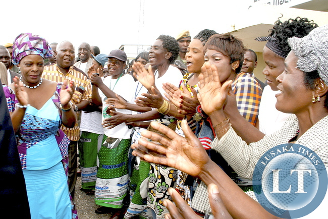 First Lady Esther Lungu  join PF women in singing upon arrival at Zambia Air Force Samora Machel Base in Mbala on March 1,2015. The First Lady is in Mbala on the outreach Programme for People with Special Needs -Picture by Thomas Nsama