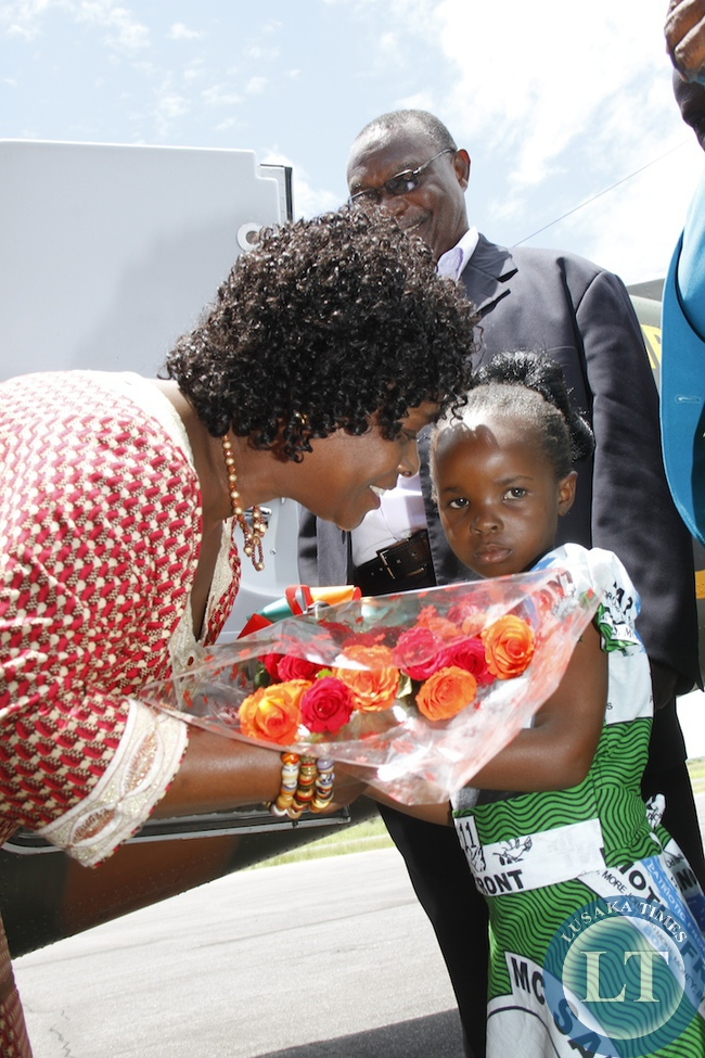 First Lady Esther Lungu receives flowers from Promise Chihana  upon her arrival at Mansa Airport   for the Outreach Programme for People with Special Needs in Mansa on February 27,2014 -Picture by THOMAS NSAMA